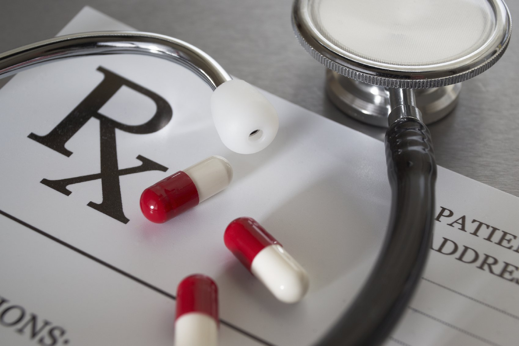 Close-up of RX  prescription and stethoscope