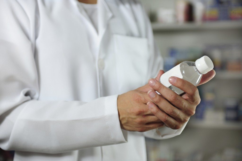 pharmacist holding a tincture